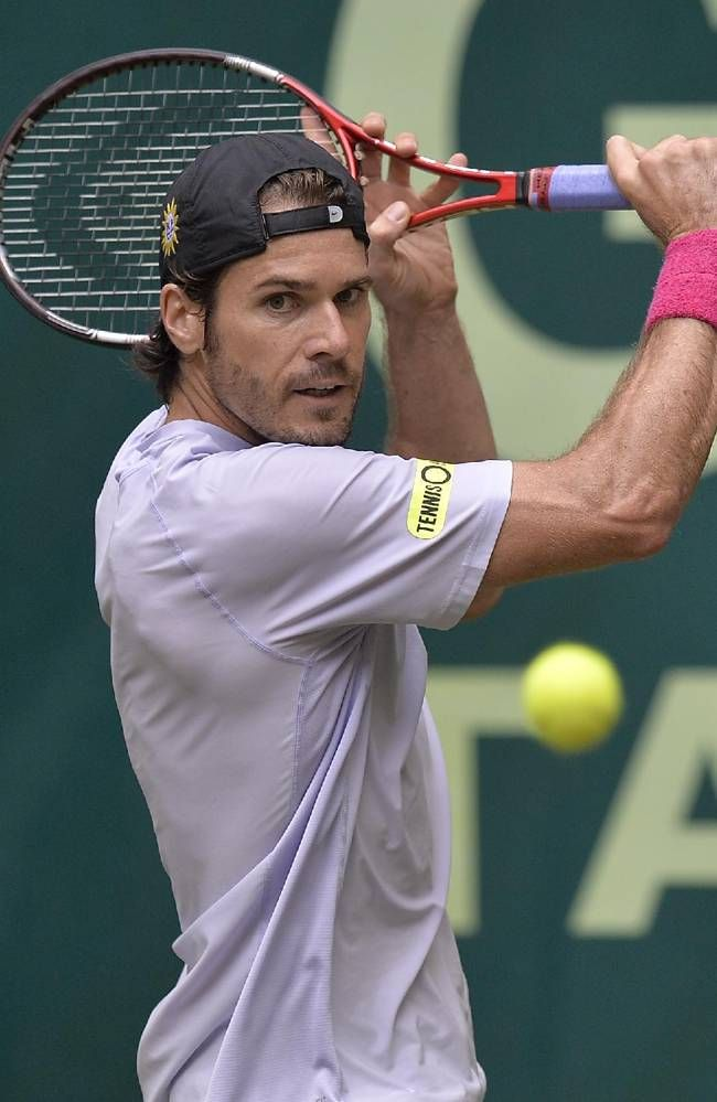 Germany's Tommy Haas  returns the ball during his semifinal tennis match against Switzerland's Roger Federer at the ATP Gerry Weber Open tornament in Halle, Westphalia, Germany, Saturday, June 15, 2013