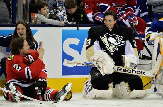 Even Chicago Blackhawks defenseman Duncan Keith can't ignore a smile from Pittsburgh Penguins Marc-Andre Fleury, the league's happiest goalie. #nhl All-Star skills competition