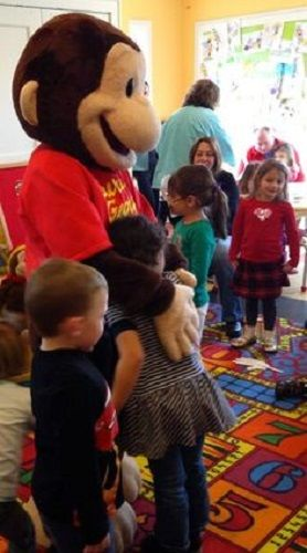 Curious George Mascot. We offer Costume Rentals along with 3 different packages for character fun visit packages.