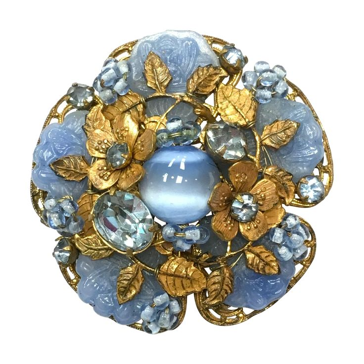 Beautiful Vintage 1960s Miriam Haskell blue poured glass, cat eye glass and rhinestone flower brooch
