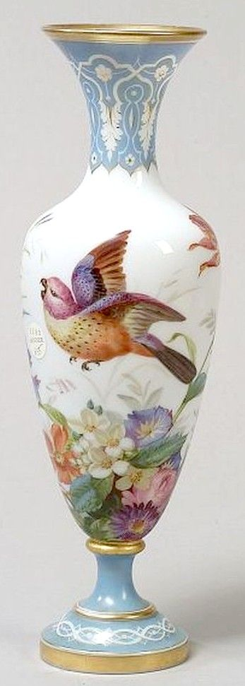 A Gorgeous French Aesthetic Movement enamel decorated opaline glass vase, slender baluster form, painted with pair of exotic parakeets amidst lush foliage, with blue transfer printed lappet rim and trumpet foot, France, circa 1876-1900