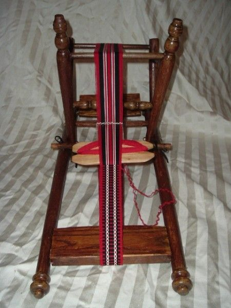 This chair was turned into an inkle loom by an extremely clever lady. You can read all about it here on Weavolution.