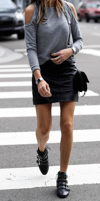 Stephanie Mooeny + cute leather min skirt + buckled leather ankle boots + stud detailing + shoulderless grey top + minimal jewellery.   Skirt: Topshop.