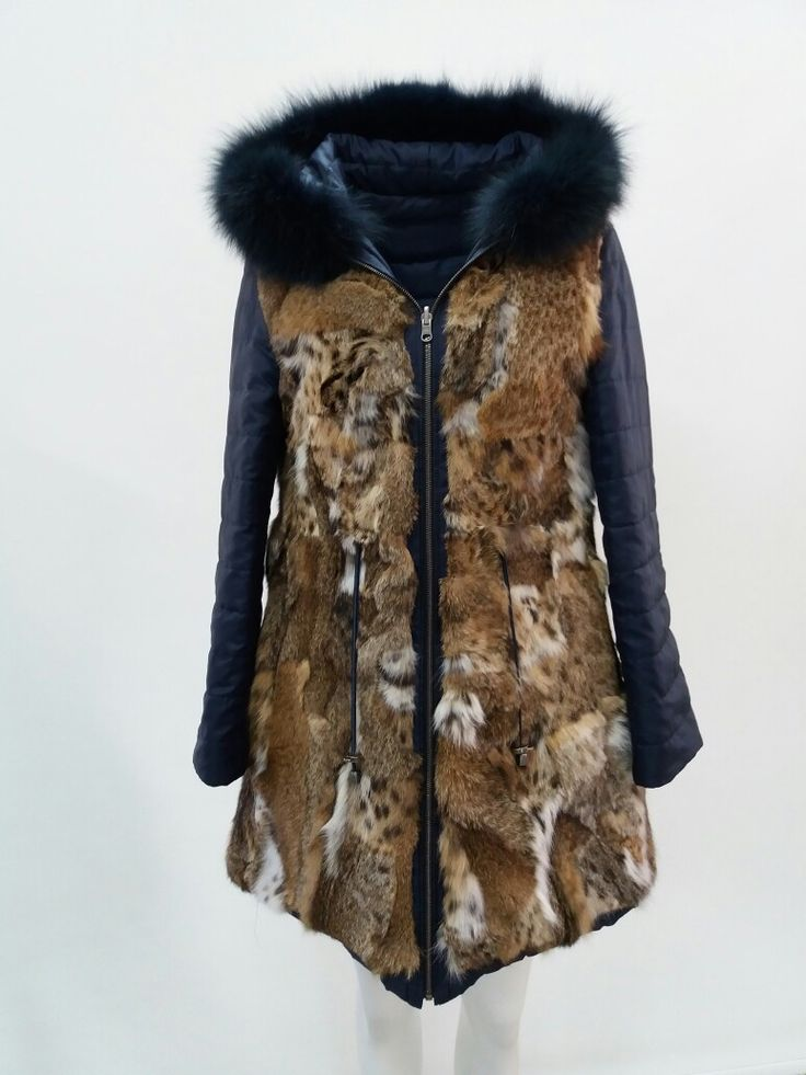 Reversible cat lynx fur parka with fox trim on hood by DOLLAS furs made in kastoria Greece