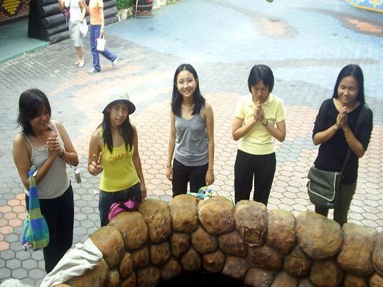 Young Girls at the Wishing Well at Safari World in Bangkok, Thailand