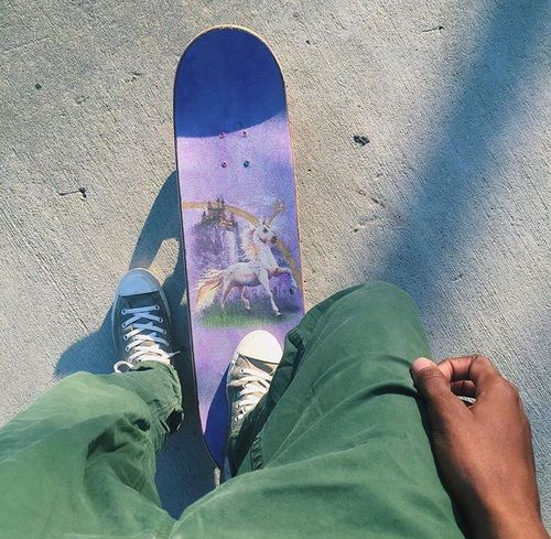 skateboard and unicorn image