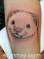 White ferret tattoo