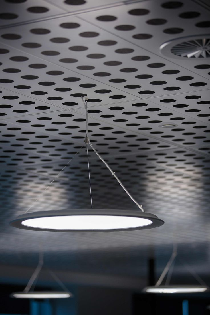 Minter Ellison Office Sydney, featuring SAS310 metal pan ceilings were specified with an unusually large perforation.