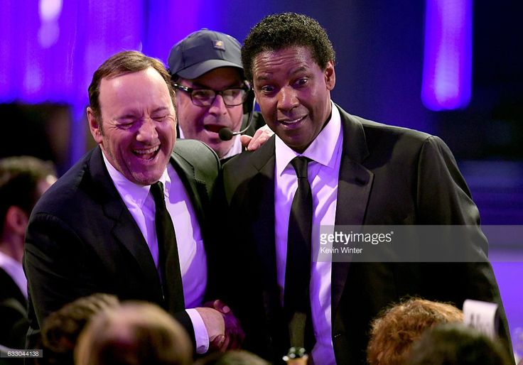 Actors Kevin Spacey (L) and Denzel Washington speak during The 23rd Annual Screen Actors Guild Awards at The Shrine Auditorium on January 29, 2017 in Los Angeles, California. 26592_014