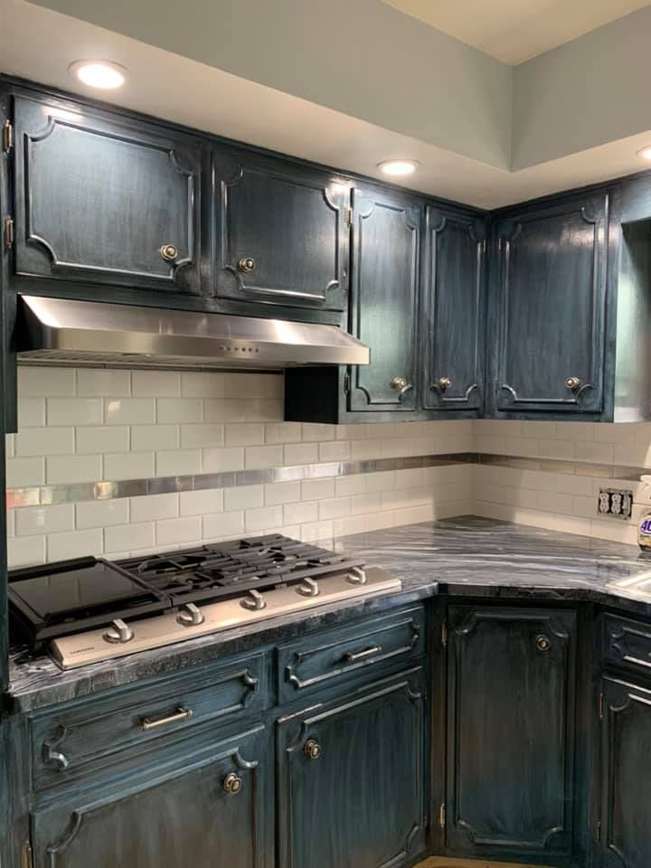Redid the cabinets with paint and glaze, installed Leggari ...