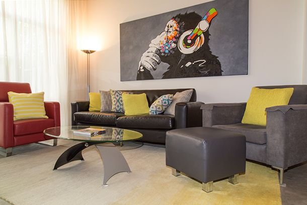 Industrial apartment styling with yellow accent tones. Interior decoration by Design Art House.