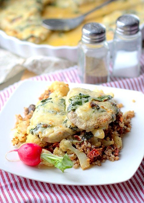 Pork chops baked with bechamel sauce with spinach