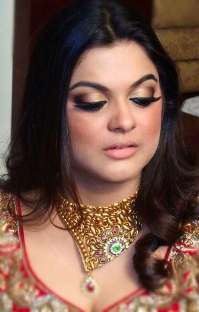 bronze smokey eye bridal makeup with nude lips, pale peach lips and gold smokey…