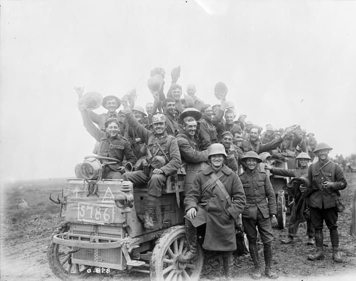 Canadians return victorious carrying war trophies from Courcelette during the Battle of the Somme, France.