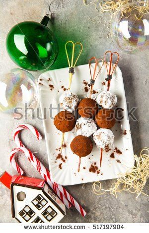Chocolate truffle candy in Christmas style. festive background with New Year toys