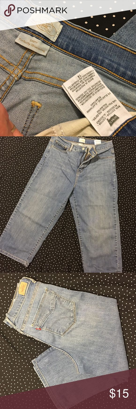 Levi's Perfectly Slimming Nickers These women's pair of Levi's jeans hold a figure-enhancing secret: A tummy slimming panel through our innovative pocket design that creates an all over smooth shape, with super-stretchy denim that ensures all-day comfort. Used condition size 14 Levi's Jeans