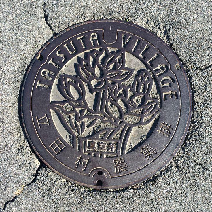 Lotus flower manhole cover.  Place: Tatsuta, Aisai city, Aichi, Japan.