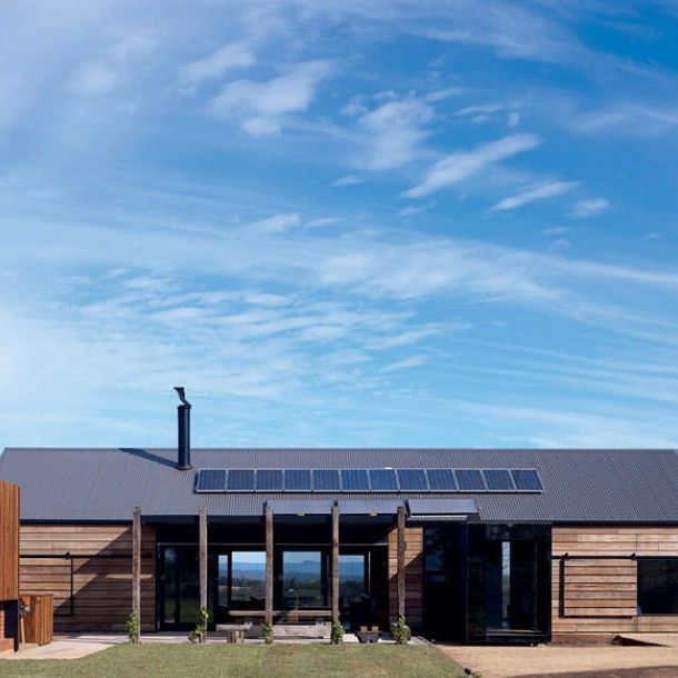 Inspired by Victorian-era farm structures of the region, this barn-like country home in rural Victoria combines numerous sustainable principles such as passive solar design, prefabrication, extensive use of recycled materials, reverse masonry veneer walls and sliding external timber sunscreens. 'Hill Plains House' | Completed 2010 | Wolveridge Architects | Victoria, Australia | Photo by Derek Swalwell  #AustralianRuralArchitecture #AustralianRuralHome #AustralianFarmhouse…