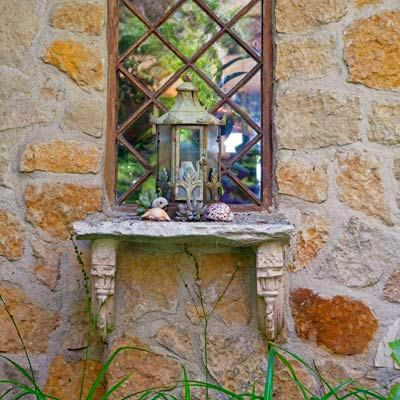 decorative lantern on a stone shelf in a garden: Lanterns Sit, This Old House, Mirror Provid, House Mobiles, Gardens Mirrors, Flats Fences Us, Hing Mirror, Old Mirror, Decoration Lanterns