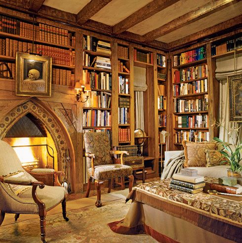 This isn't what I picture my library in my dream home to look like, but it reminds me to keep dreaming of a library (and I like the fireplace!)  (in my mind: french windows, red walls, white trim and shelving, fireplace, two comfy reading chairs, a small writing desk, great lighting - both natural and artificial - and with a secret entrance. see previous photo : )