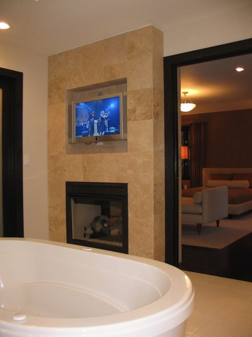 10 images about fireplace on pinterest fireplace tiles for Tv in bathroom ideas