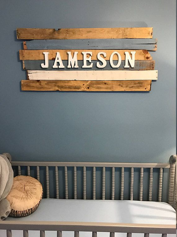 Wood sign for baby's name in the nursery. Love the rustic touches, worn edges, & warm colors.