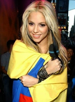 Shakira wrapped in Colombian flag