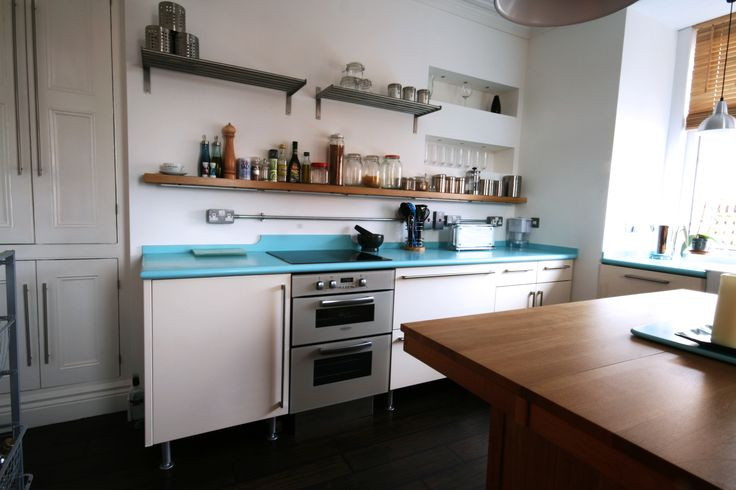 Vibrant 1950's inspired kitchen renovation.  For a free consultation call: 0113 262 5954 http://www.redesignexperts.co.uk/