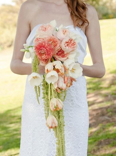 peachy-pink garden roses, white parrot tulips, pale peach tulips, green hanging amaranthus, blush pink sweet peas and white sweet peas wrapped in ivory ribbon.