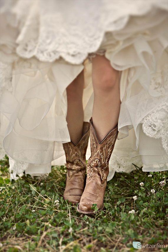 cowboy boots on a bride. LOVE. #fall #wedding #trends via Top 10 Fall Wedding Trends