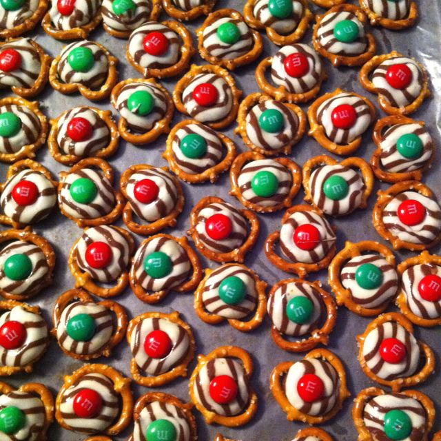 Christmas candy & super easy to make! Melt Hershey's kisses onto tiny twist pretzels (275 degrees, 3 minutes), remove, and immediately press a single m on each. Refrigerate until eating to make sure they are solid.