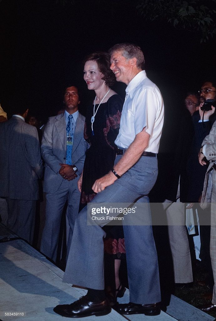 First Lady Rosalynn Carter and President Jimmy Carter watch the stage during a…