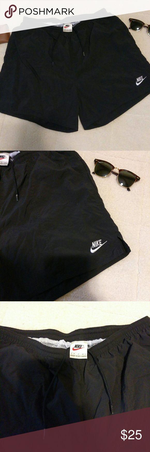 Vintage Black Nike Swim Trunks Vintage Nike black swim shorts with embroidered logo and white mesh lining Nike Swim Swim Trunks