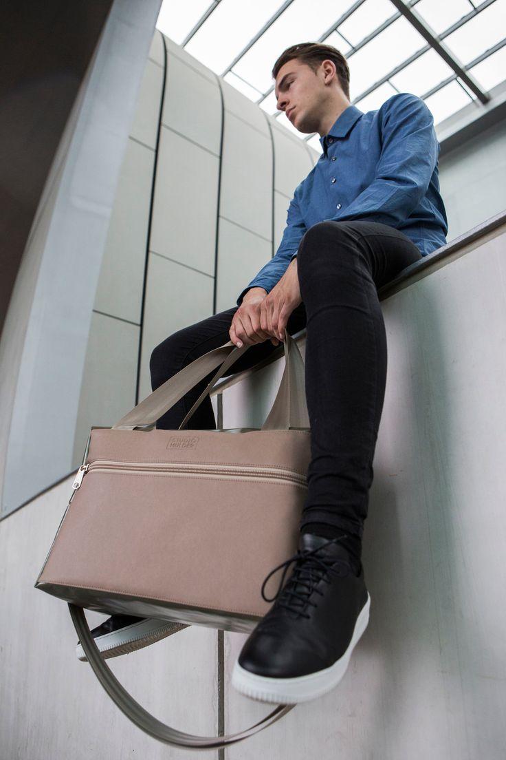 Blues shirt with black skinny jeans by RATNA HO + STUDIO MULDER