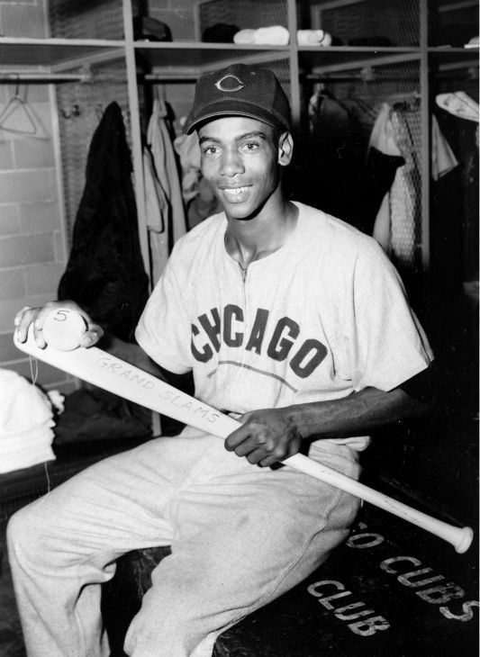 Ernie Banks of the Chicago Cubs holds his grand slam bat and ball after setting a new record with his fifth bases-loaded homer in St. Louis, Mo., Sept. 19, 1955.  (AP Photo) <span class=meta>AP Photo/ XNBG</span>