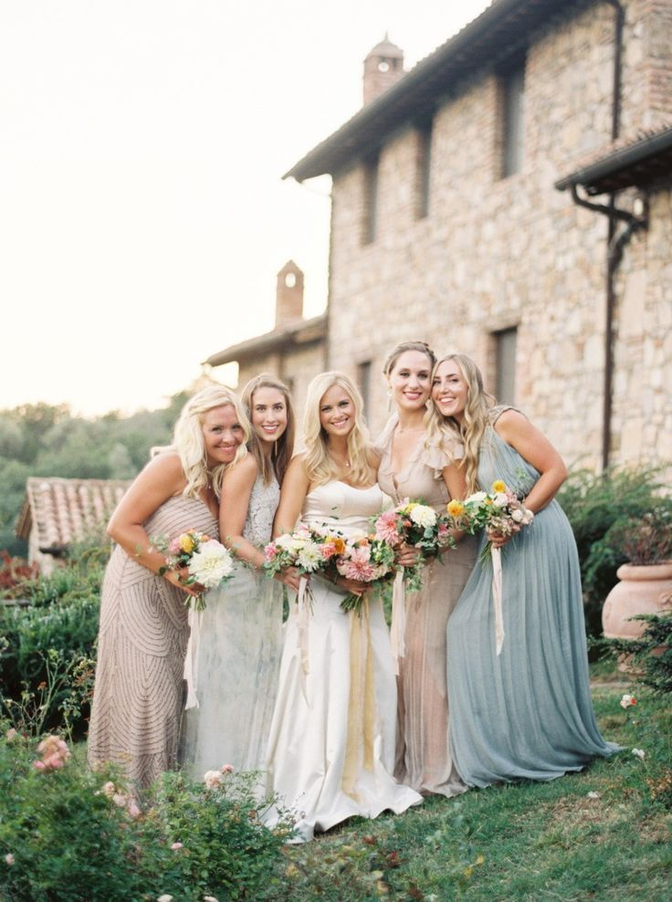 This stunning bride poses perfectly with her bridesmaids.