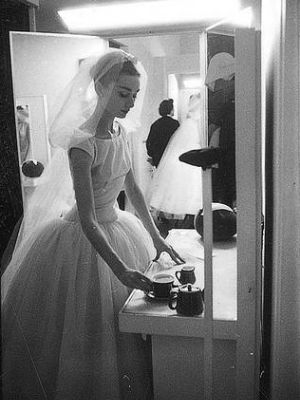 Audrey Hepburn in 1956 during a fitting for the Givenchy wedding dress that she wore in Funny Face