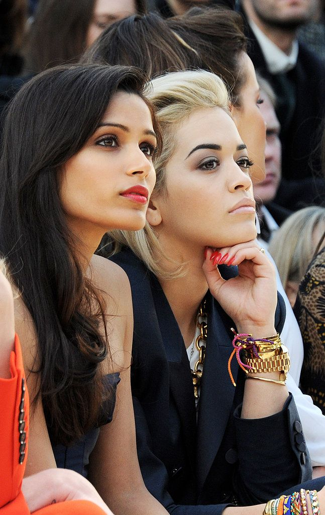 Rita Ora and Freida Pinto: Rita Ora showed off her red manicure from the front row, while Freida Pinto wore a similar shade on her lips.
