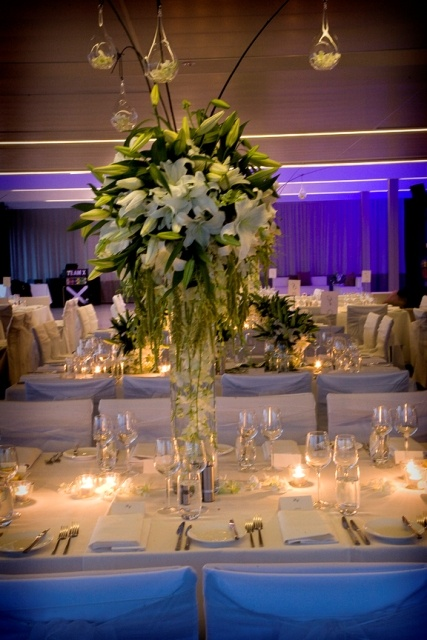 Tall centrepieces are a great way to add height and elegance to the room.