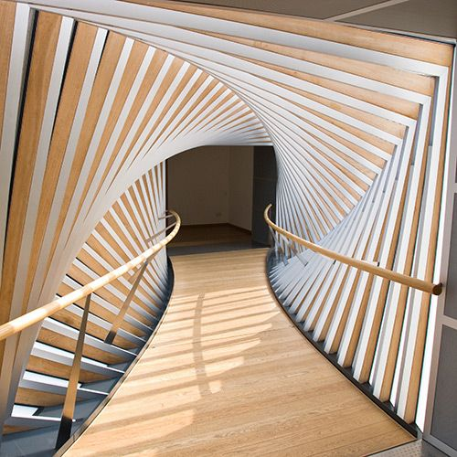 MOVEMENT: This hallway is an example of movement in an interior design. The way that the beams are shaped around the hall makes it appear as if it is moving and that makes the space unique.