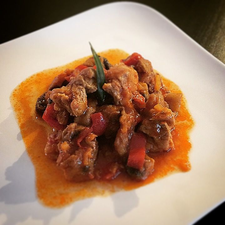 Greek kitchen-Pork with vegetables, red sauce and greek olive oil
