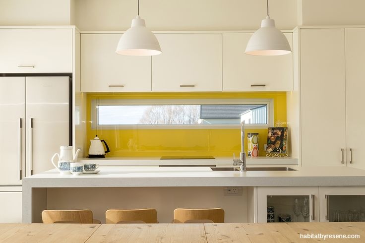 Sometimes less is more. A kitchen splashback in Resene Bright Lights is a zesty slice of colour in this naturally sun-filled kitchen. http://www.habitatbyresene.co.nz/5-strong-not-scary-colours