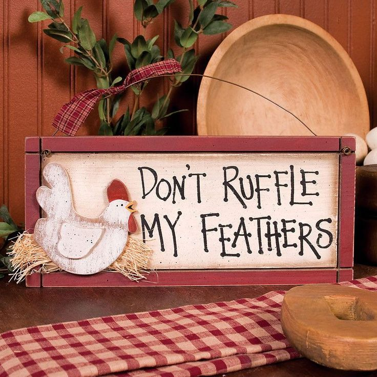 """""""Don't Ruffle My Feathers"""" novelty sign. Made of painted wood and wire with cloth accent bow and 3D cutouts. Dimensions: 5.5"""" H x 12"""" W x 1.125"""" D Shipping weight: 2 lbs. CLEARANCE! This item has been"""