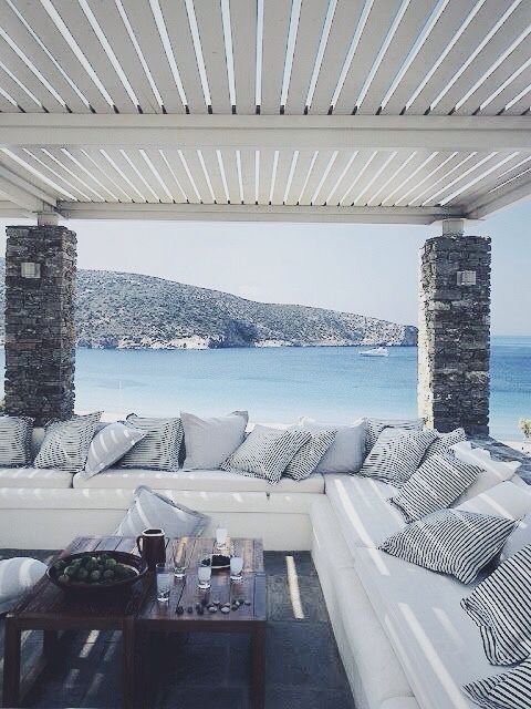 Heaven!!! Can I live there and literally sit on that couch every night looking out into the water? Beautiful!