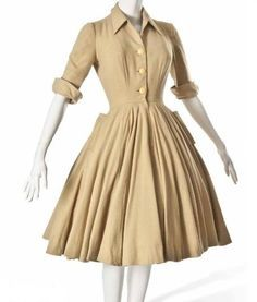 Day Dress, Christian Dior: ca. 1947-1948, wool, three-quarter length turn-up sleeves, bodice with three buttons, the skirts full, with pockets to the hips.