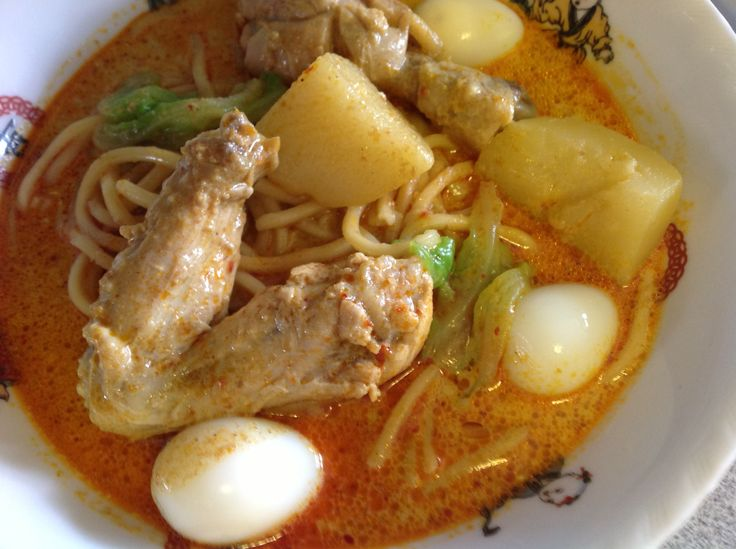 Chicken & potato curry served with noodles, hard boiled quail eggs ...