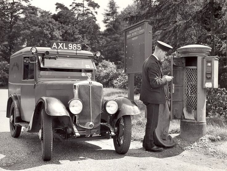Postman collecting mail from pillar box.. 1935