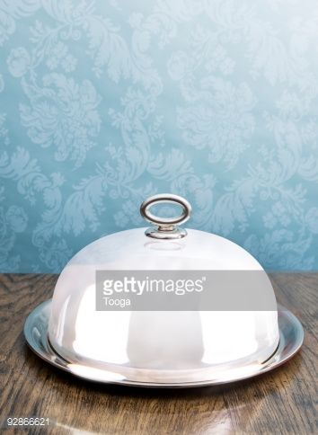 Stock Photo : Silver coved serving dish on dining table