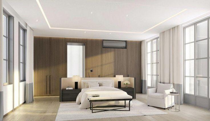 faux plafond moderne avec spots LED intégrés, dressing intégré, lit design et tapis blanc