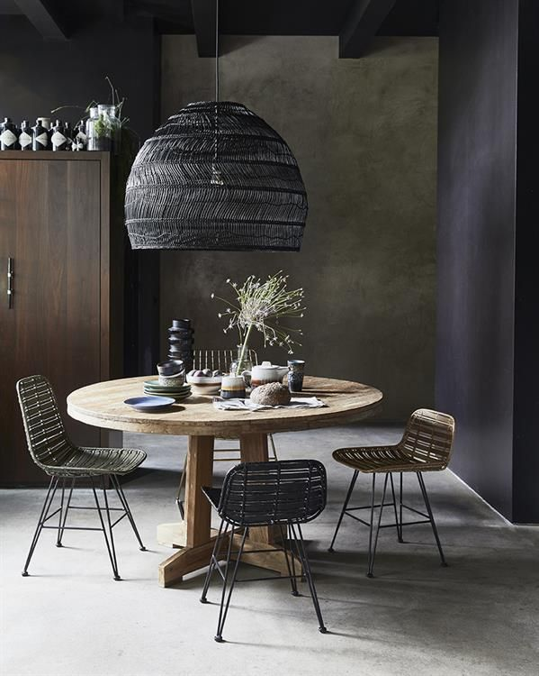 oversize pendant in black rattan, wood table and wicker chairs available from Out There Interiors